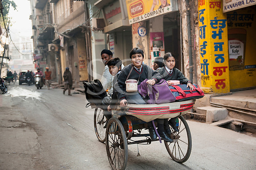 Amritsar, Punjab, India. Going to school in a rickshaw.