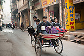 Amritsar, Punjab, India. Going to school in a rickshaw.