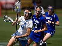Jenn Russell (9) of North Carolina is followed by Danielle Kachulis (3) and Sarah Bullard (1) of Duke during the ACC women's lacrosse tournament semifinals in College Park, MD.  North Carolina defeated Duke, 14-4.