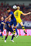 Borussia Dortmund midfielder Sebastian Rode (l) and Manchester United midfielder Jesse Lingard (l) heads the ball during the International Champions Cup China 2016, match between Manchester United vs Borussia  Dortmund on 22 July 2016 held at the Shanghai Stadium in Shanghai, China. Photo by Marcio Machado / Power Sport Images
