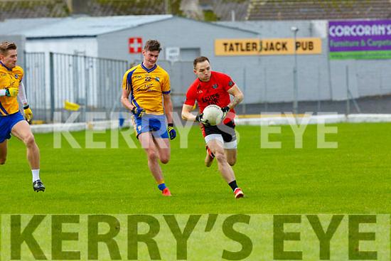Darren O'Sullivan Glenbeigh-Glencar goes past Ethan Coffey Beaufort during their Club Intermediate qf in Fitzgerald Stadium on Sunday