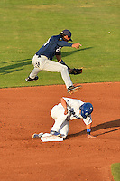 Angel Ortega (10) of the Helena Brewers leaps high over  Kyle Farmer (18) of the Ogden Raptors in Pioneer League play at Lindquist Field on July 23, 2013 in Ogden Utah. (Stephen Smith/Four Seam Images)