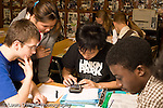 Education High School Mathematics class group of students working at a table horizontal