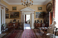 Inwood house is repleat with paintings and ornaments of horses and dogs, as can be seen here, flanking a hall doorway