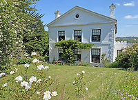 BNPS.co.uk (01202 558833)<br /> Pic: LillicrapChilcott/BNPS<br /> <br /> Pictured: The house.<br /> <br /> A sprawling waterfront estate that has been in the same family for half a century is on the market for £2.25m.<br /> <br /> Bellscat Farmhouse is a pretty Grade II listed home with beautiful far-reaching views over Fowey River in Cornwall.<br /> <br /> The grand four-bedroom home looks a far cry from a typical farmhouse and is believed to have been two farm cottages that were converted into one home.<br /> <br /> There is also a separate two-bedroom barn and the properties sit in 37 acres of undulating land, creating a private and scenic estate.
