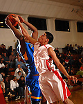 Roger Ortiz fights for a rebound at St. Thomas High School Friday  Feb. 2,2007.(Dave Rossman/For the Chronicl01