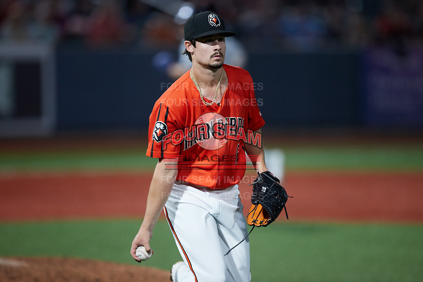 Aberdeen IronBirds relief pitcher Kade Strowd (6) walks the baseball towards first base during the game against the Hudson Valley Renegades at Leidos Field at Ripken Stadium on July 23, 2021, in Aberdeen, MD. (Brian Westerholt/Four Seam Images)