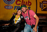 Nov 17, 2019; Pomona, CA, USA; NHRA pro stock motorcycle rider Jianna Salinas celebrates with photographer Mark Rebilas after winning the Auto Club Finals at Auto Club Raceway at Pomona. Mandatory Credit: Mark J. Rebilas-USA TODAY Sports