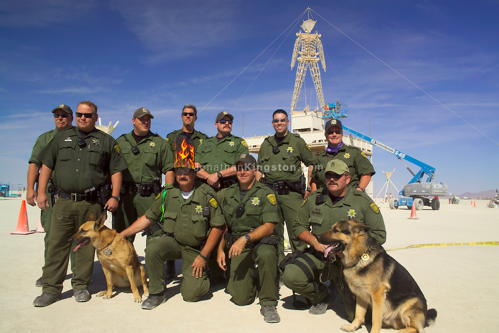 Federal Bureau Of Land Management Rangers In Front Of The Man In Black Rock City Nevada Kingston Images