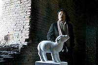 """L'artista cinese Huang Rui posa vicino ad una statua di pietra raffigurante uno degli animali dello zodiaco cinese, parte della sua grande installazione """"Pechino 2008: il tempo, gli animali, la storia"""", al Museo delle Mura di Porta San Sebastiano, Roma, 8 febbraio 2008..Chinese artist Huang Rui poses near a stone carving representing one of the animals of the Chinese zodiac, part of his large-scale installation """"Beijing 2008: Animal time in Chinese history"""" at Rome's Wall Museum of St. Sebastien's Door, 8 february 2008..UPDATE IMAGES PRESS/Riccardo De Luca"""