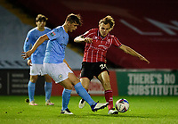 Lincoln City's Harry Anderson battles with Manchester City U21's Callum Doyle<br /> <br /> Photographer Andrew Vaughan/CameraSport<br /> <br /> EFL Papa John's Trophy - Northern Section - Group E - Lincoln City v Manchester City U21 - Tuesday 17th November 2020 - LNER Stadium - Lincoln<br />  <br /> World Copyright © 2020 CameraSport. All rights reserved. 43 Linden Ave. Countesthorpe. Leicester. England. LE8 5PG - Tel: +44 (0) 116 277 4147 - admin@camerasport.com - www.camerasport.com