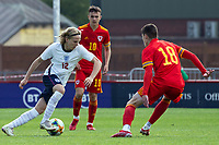 3rd September 2021; Newport, Wales:  Sammy Braybrooke of England takes on Joel Cotterill of Wales during the U18 International Friendly match between Wales and England at Newport Stadium in Newport, Wales.
