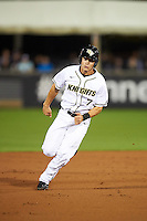 UCF Knights designated hitter Ryan Crile (7) running the bases during a game against the Siena Saints on February 17, 2017 at UCF Baseball Complex in Orlando, Florida.  UCF defeated Siena 17-6.  (Mike Janes/Four Seam Images)
