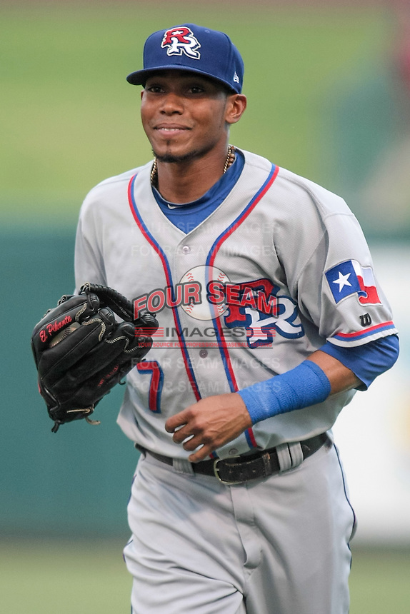 Engel Beltre (7) of the Round Rock Express heads to the dugout at the end outfield an inning during the Pacific Coast League game against the Oklahoma City RedHawks at Chickashaw Bricktown Ballpark on June 14, 2013 in Oklahoma City ,Oklahoma.  (William Purnell/Four Seam Images)