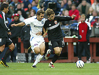 3 April 2004: Earthquakes Brian Mullan battles for the ball against DC United Bobby Convey at RFK Stadium in Washington D.C..  Credit: Michael Pimentel / ISI