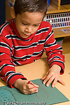 Preschool children ages 3-4 art activity boy drawing with crayon using right hand recognizable shape vertical