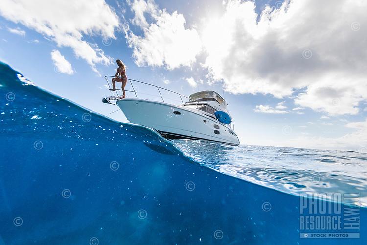 A woman enjoys the day on a power cruiser off of Waikiki, Honolulu, O'ahu.