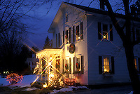 Stockbridge, Berkshires, Massachusetts, Christmas starlights and candles in the windows decorate the beautiful Four Seasons Bed & Breakfast at night in Stockbridge in the state of Massachusetts.