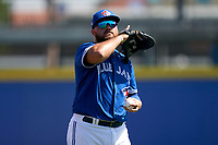 Toronto Blue Jays Rowdy Tellez (44) during warmups before a Major League Spring Training game against the Pittsburgh Pirates on March 1, 2021 at TD Ballpark in Dunedin, Florida.  (Mike Janes/Four Seam Images)