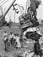 1970 File - <br /> <br /> Smashed jet engine, from the Air Canada DC-8 airliner that plunged to each Sunday north of Toronto International Airport, is hoisted by a crane yesterday and moved away from the crash site to facilitate the search for bodies. The engine was so badly damaged it started to break apart as it was lifted. Many of the bodies of the 108 dead are so badly mutilated that they may never be idenfitied.<br /> <br /> Photo : Boris Spremo - Toronto Star archives - AQP
