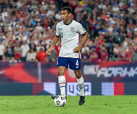 NASHVILLE, TN - SEPTEMBER 5: Tyler Adams #4 of the United States dribbles during a game between Canada and USMNT at Nissan Stadium on September 5, 2021 in Nashville, Tennessee.