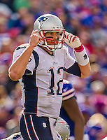 12 October 2014: New England Patriots quarterback Tom Brady calls out signals during a game against the Buffalo Bills at Ralph Wilson Stadium in Orchard Park, NY. The Patriots defeated the Bills 37-22 to move into first place in the AFC Eastern Division. Mandatory Credit: Ed Wolfstein Photo *** RAW (NEF) Image File Available ***