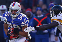 BUFFALO, NY - NOVEMBER 28:  David Nelson #86 of the Buffalo Bills runs around the Pittsburgh Steelers defense after completing a catch during the game on November 28, 2010 at Ralph Wilson Stadium in Orchard Park, New York.  (Photo by Jared Wickerham/Getty Images)