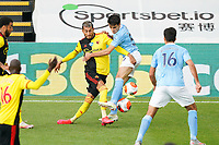 Roberto Pereyra of Watford and Eric Garcia of Man City during the Premier League match between Watford and Manchester City at Vicarage Road, Watford, England on 21 July 2020. Football Stadiums around remain empty due to the Covid-19 Pandemic as Government social distancing laws prohibit supporters inside venues resulting in all fixtures being played behind closed doors until further notice.<br /> Photo by Andy Rowland.