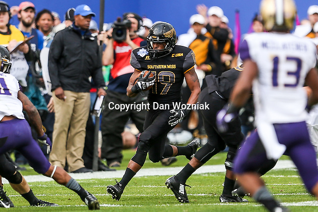 Southern Miss Golden Eagles defensive back Curtis Mikell (19) in action during the Zaxby's Heart of Dallas Bowl game between the Washington Huskies and the Southern Miss Golden Eagles at the Cotton Bowl Stadium in Dallas, Texas.