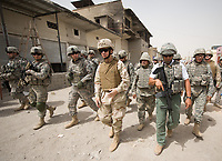 Chairman of the Joint Chiefs of Staff Navy Adm. Mike Mullen  takes a walking tour of Sadr City in Baghdad, Iraq, July 7, 2008. Mullen is on a six-day tour of the region while hosting a USO tour. DoD photo by Mass Communication Specialist 1st Class Chad J. McNeeley. (Released)