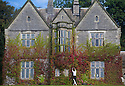 21/09/16 <br /> <br /> Handyman Michael Butler (32) tidies up the Virginia creeper covering Callow Hall Hotel, a 19th century mansion near Ashbourne on the edge of the Derbyshire Peak District, ahead of the first day of autumn on Thursday. <br /> <br /> It's the most colourful display ever, helped by the late Indian Summer warmth of early September, according to Cara Ferguson, deputy manager of the hall, which is a popular spot for country weddings.<br /> <br /> All Rights Reserved: F Stop Press Ltd. +44(0)1773 550665   www.fstoppress.com