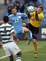 Charlotte Goal Keeper Klay Davis makes a save on a charging Ben Speas (17) of North Carolina during the NCAA 2011 Men's College Cup in Hoover, AL on Sunday, December 11, 2011.