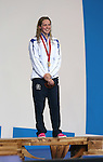 Glasgow 2014 Commonwealth Games<br /> An emotional Hannah Miley stands on the podium after she wins gold in the Women's 400m Individual Medley.<br /> Tollcross Swimming Centre<br /> <br /> 24.07.14<br /> ©Steve Pope-SPORTINGWALES