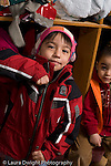 Education Preschool 3-4 year olds fine motor skills boy zipping coat vertical