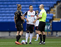 Bolton Wanderers' Antoni Sarcevic (centre) and Oldham Athletic's Carl Piergianni (left) are briefed before kick-off by referee Robert Madley <br /> <br /> Photographer Andrew Kearns/CameraSport<br /> <br /> The EFL Sky Bet League Two - Bolton Wanderers v Oldham Athletic - Saturday 17th October 2020 - University of Bolton Stadium - Bolton<br /> <br /> World Copyright © 2020 CameraSport. All rights reserved. 43 Linden Ave. Countesthorpe. Leicester. England. LE8 5PG - Tel: +44 (0) 116 277 4147 - admin@camerasport.com - www.camerasport.com