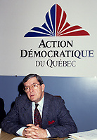 Jean Allaire (M), leader<br /> Action démocratique du Québec (ADQ),<br /> in March 1994<br /> <br /> This party was founded in 1994 by Québec LIBERAL PARTY dissidents. After the rejection of the CHARLOTTETOWN ACCORD in October 1992, Mario Dumont, leader of the Young Liberals of Québec, and Jean Allaire a member of the executive committee of the Québec Liberal Party, left the Liberal Party when its members decided not to defend their platform proposition of 22 fields of exclusive jurisdiction claimed on behalf of Québec.<br /> <br /> The dissidents formed an initial amalgamation, le groupe de Réflexion Québec, followed in December 1993 by Action Québec. The (ADQ) party was founded only the following year, placing Mario Dumont, 23, the youngest party leader in Québec, at its head. The ADQ presented its first electoral platform on 5 and 6 March 1994, when 612 delegates from all the Québec regions adopted a Plan national de redressement (National recovery plan), bearing some twenty propositions aimed at elaborating an economic strategy and stabilizing government finances.<br /> <br /> In the September 1994 elections, the ADQ elected only a single candidate, Mario Dumont, in Rivière-du-Loup, but still obtained nearly 10 percent support of Quebec voters, even if it did not present candidates in all the electoral districts.<br /> <br /> In June 1995, Mario Dumont, Lucien BOUCHARD, then leader of the BLOC QUÈBÈCOIS, and Jacques PARIZEAU, leader of the PARTI QUÈBECOIS, signed an agreement that united these three parties within the Yes camp and partnered them for the formulation of the referendum question (see QUÈBEC REFERENDUM 1995).<br /> <br /> In the 30 November 1998 elections, only Mario Dumont was elected, again in Rivière-du-Loup, if the ADQ increased its percentage of support, by about 500 000 votes. The ADQ did not succeed in passing the critical voting threshold of 15 percent, making it a third party. However, the ADQ fought for proportional representation in the NA