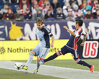 Sporting Kansas City defender Chance Myers (7) clears the ball as New England Revolution midfielder Diego Fagundez (14) defends. In the first game of two-game aggregate total goals Major League Soccer (MLS) Eastern Conference Semifinal series, New England Revolution (dark blue) vs Sporting Kansas City (light blue), 2-1, at Gillette Stadium on November 2, 2013.
