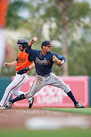 GCL Braves shortstop Vaughn Grissom (12) attempts to turn a double play as Trevor Kehe (16) runs to second during a Gulf Coast League game against the GCL Orioles on August 5, 2019 at Ed Smith Stadium in Sarasota, Florida.  GCL Orioles defeated the GCL Braves 4-3 in the first game of a doubleheader.  (Mike Janes/Four Seam Images)