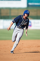 Omar Carrizales (19) of the Asheville Tourists hustles towards third base against the Kannapolis Intimidators at Intimidators Stadium on June 28, 2015 in Kannapolis, North Carolina.  The Tourists defeated the Intimidators 6-4.  (Brian Westerholt/Four Seam Images)