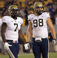 Pitt defensive linemen Brandon Lindsey (7) and Chas Alecxih (98). The WVU Mountaineers beat the Pitt Panthers 21-20 at Mountaineer Field in Morgantown, West Virginia on November 25, 2011.