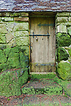 """Aging door in moss covered stone cabin deep in forest.  """"Portland's Secret Garden"""",  Leach Garden was established by JOhn and Lilla Leach in the 1930's.  The Garden continues as a public place of respite and native northewest botanical display.  Operated by the city of Portland, Oregon.."""
