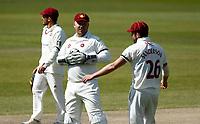 15th April 2021; Emirates Old Trafford, Manchester, Lancashire, England; English County Cricket, Lancashire versus Northants; Northamptonshire keeper Adam Rossington shares a joke with Ben Sanderson