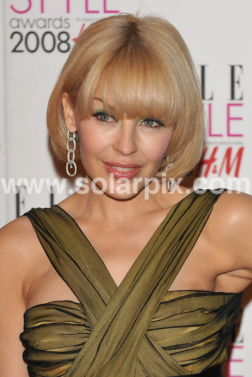 **ALL ROUND PICTURES FROM SOLARPIX.COM**.**WORLDWIDE SYNDICATION RIGHTS**.Celebrities arrive for the Elle Style Awards at The Roundhouse, London. 12th February 2008..This pic: Kylie Minogue..JOB REF: 5777 ATM     DATE: 12_02_2008.**MUST CREDIT SOLARPIX.COM OR DOUBLE FEE WILL BE CHARGED* *UNDER NO CIRCUMSTANCES IS THIS IMAGE TO BE REPRODUCED FOR ANY ONLINE EDITION WITHOUT PRIOR PERMISSION*