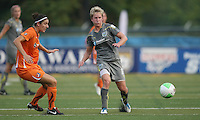 Sky Blue midfielder, Yael Averbuch (13) passes the ball wide as Philadelphia midfielder, Joanna Lohman (17) steps in.  The Philadelphia Independence scored three first half goals, and went on to win 4-1 over Sky Blue at John A Farrell Stadium in West Chester, Pennsylvania.