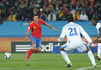 Spanish midfielder Sergio Busquets drops the ball into the path of offensive suppport. Spain defeated Honduras, 2-0, in their second match of play in Group H  in a match played Monday, June 21st, at Ellis Park in Johannesburg, South Africa at the 2010 FIFA World Cup..