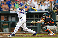 Florida Gators first baseman Peter Alonso (20) follows through on his swing against the Miami Hurricanes in the NCAA College World Series on June 13, 2015 at TD Ameritrade Park in Omaha, Nebraska. Florida defeated Miami 15-3. (Andrew Woolley/Four Seam Images)