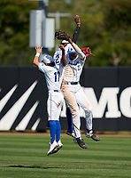 IMG Academy Ascenders outfielders Max Galvin (17), Elijah Green (2), and James Wood (23) celebrate after closing out a game against the Calvary Christian Academy Eagles on March 13, 2021 at IMG Academy in Bradenton, Florida.  (Mike Janes/Four Seam Images)