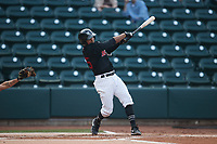 Lenyn Sosa (25) of the Winston-Salem Warthogs follows through on his swing against the Jersey Shore BlueClaws at Truist Stadium on July 21, 2021 in Winston-Salem, North Carolina. (Brian Westerholt/Four Seam Images)