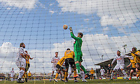 Roy Carroll of Notts County wins a cross under pressure from Dean Morgan of Newport County during the Sky Bet League 2 match between Newport County and Notts County at Rodney Parade, Newport, Wales on 30 April 2016. Photo by Mark  Hawkins / PRiME Media Images.