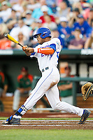Florida Gators outfielder Buddy Reed (23) swings the bat against the Miami Hurricanes in the NCAA College World Series on June 13, 2015 at TD Ameritrade Park in Omaha, Nebraska. Florida defeated Miami 15-3. (Andrew Woolley/Four Seam Images)